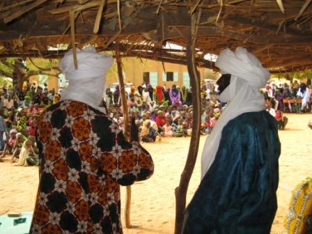 2 A judge and an NGO fighting slavery make a speech on Human Rights and rights of women to the vilage crowd